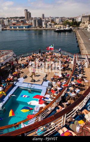 Spain, Galicia, A Coruna, MV Marco Polo passengers being entertained on deck in harbour - Stock Image
