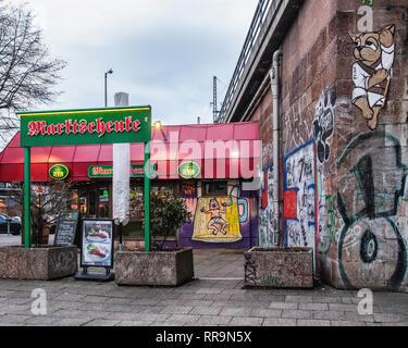 Berlin, Mitte  Marktschenke Bar. Small bar and fast food venue next to railway viaduct in Karl-Liebknecht-Strasse - Stock Image