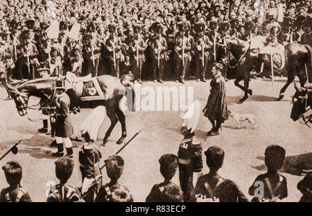 King Edward VII's favourite dog, Caesar, following the king's charger (horse) during Edward's funeral on the morning of 17 May 1910. His coffin was placed on a gun carriage and drawn by black horses to Westminster Hall, with the new King (George V) and his family walking behind. Following a brief service, the royal family left, and the hall was opened to the public; over 400,000 people filed past the coffin over the next two days. - Stock Image