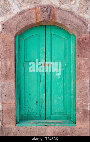 Window with green wooden shutters, Tejeda, Gran Canaria, Canary Islands - Stock Image