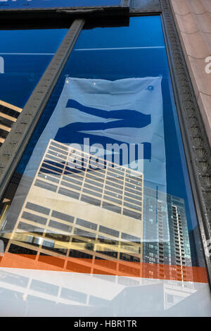 Fly the W flag in the window of a building, Chicago, Illinois. - Stock Image