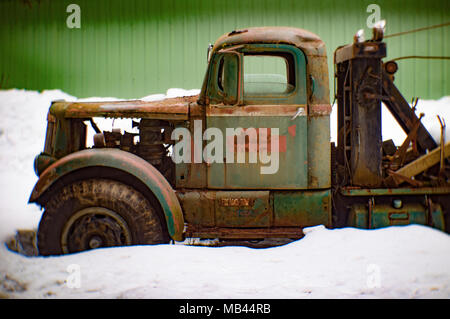 A 1942 White Super Power 2 1/2 ton winch truck on the side of a metal barn, in Noxon, Montana  This image was shot with an antique Petzval lens and wi - Stock Image