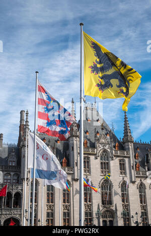 Bruges city flags fly outside the Provincial Court building, Markt, Bruges, West Flanders, Belgium - Stock Image