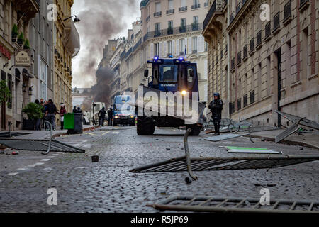 Paris, France. 1st December, 2018.  Gendarmerie military vehicle cleaning streets during the Yellow Vests protest against Macron politic. Credit: Guillaume Louyot/Alamy Live News - Stock Image