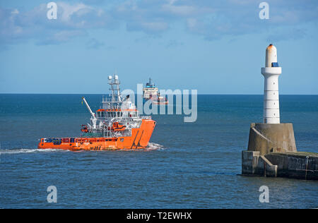 The Cygnus Sentinel OffshoresUPPLY vessel leaves its home port of Aberdeen to a destination  in the North Sea. - Stock Image