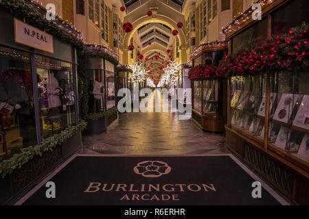 London, UK - December 4th 2018: A view of the beautiful Burlington Arcade in Mayfair, London, decorated with Christmas decorations. - Stock Image