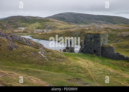 Dunlough Castle in West Cork wich amazing landscape on the background. - Stock Image