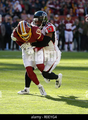 Maryland, USA. 4th Nov, 2018. Washington Redskins WR #13 Maurice Harris catches a pass and is tackled by Atlanta Falcons CB #34 Brian Poole during a NFL football game between the Washington Redskins and the Atlanta Falcons at FedEx Field in Landover, MD. Justin Cooper/CSM/Alamy Live News - Stock Image