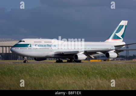 Cathay Pacific Airways Boeing 747-467 taxiing for departure at London Heathrow airport. - Stock Image