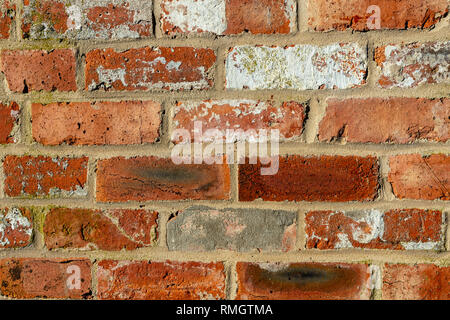 close up of a brick wall that has been build with old bricks - Stock Image
