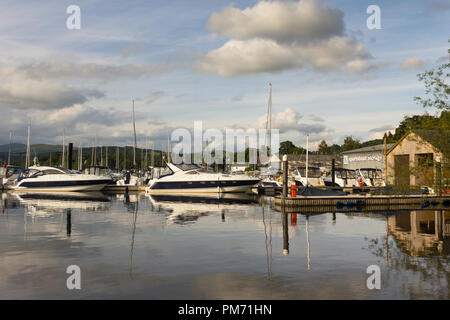 Two Fairline motor boats moored at a jetty at the marina of Windermere Aquatic Ltd, motor boat and yacht dealers, Bowness on Windermere, Cumbria. - Stock Image