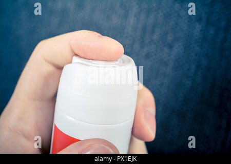 Using An Aluminium Spray Can As A Parfume Or A Chemical Aerosol - Stock Image