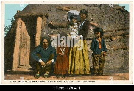 Navajo Indian family and their temporary hut (known as a Hogan), Arizona, USA.      Date: circa 1910 - Stock Image