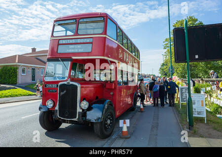 A preserved vintage United Bus Company Bristol BGL29 bus loading passengers for a demonstration run at Marske by the Sea North Yorkshire England - Stock Image