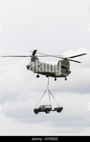 RAF Chinook deploying RAF Regiment Troops - Stock Image