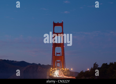 Traffic on the Golden Gate Bridge at dusk, San Francisco, California, USA - Stock Image