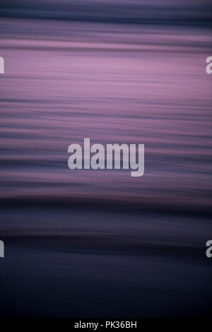 Abstract of water in the ocean, blurred using intentional camera movement - Stock Image
