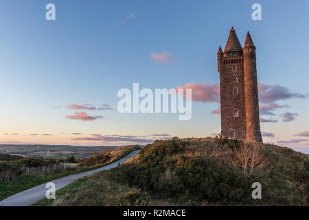 Scrabo Tower at sunset. A local landmark on Scrabo Hill visible from many miles. Newtownards, County Down, N.Ireland. - Stock Image
