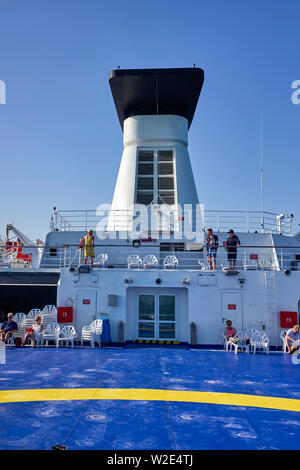 Passengers on the rear deck of a cross channel ferry coming into the UK from Brittany - Stock Image