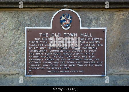 A Brown information sign on the Old Town Hall Harrogate, now the Mercer Art Gallery - Stock Image