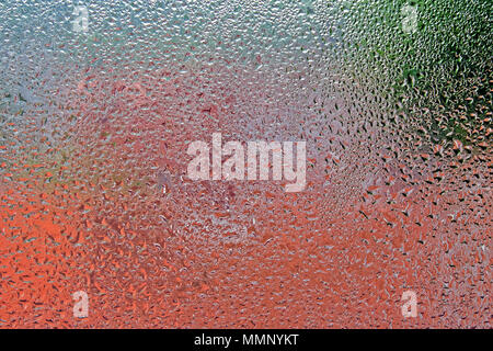 Window condensation reflecting outdoor colours - Stock Image
