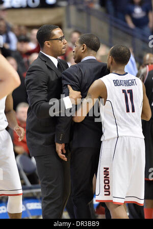 Storrs, CT, USA. 18th Jan, 2014. Saturday January 18, 2014: Connecticut Huskies Head coach Kevin Ollie is restrained - Stock Image