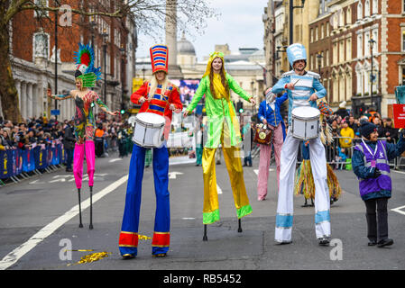 Heartburn Entertainment stilt walkers in Whitehall at London's New Year's Day Parade 2019. London, UK. Stilt walking in costumes - Stock Image