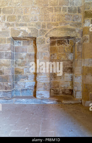 Recessed frame (Niche) in an old stone bricks wall, Medieval Cairo, Egypt - Stock Image