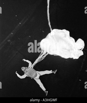 Russell Powell BASE Jumping at night off Hilton Hotel Hyde Park London Great Britain - Stock Image