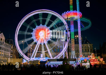 Funfair on Dam Square, Amsterdam, Netherlands - Stock Image