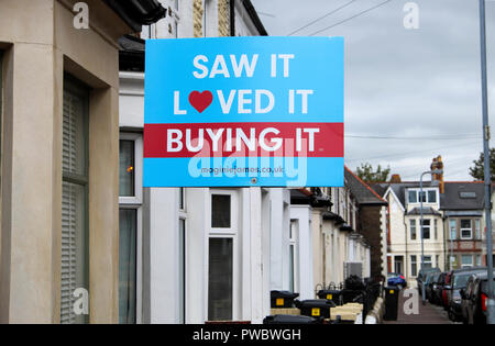 'Saw It, Loved It, Buying It' sold estate agent property sign outside a terraced house in Roath, Cardiff Wales UK  KATHY DEWITT - Stock Image