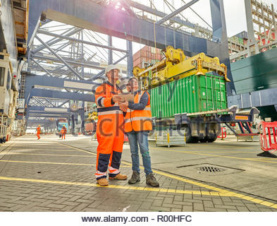 Dock workers using tablet PC at Port of Felixstowe, England - Stock Image