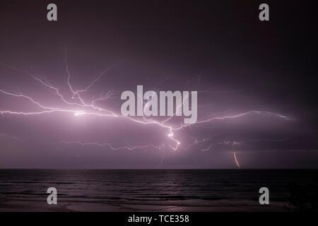 Lightning storm at sea, Australia - Stock Image