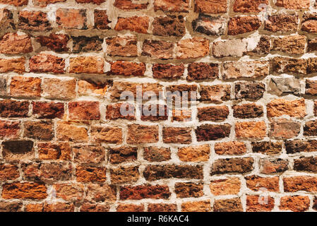 Red brick wall texture background; Old weathered wall background - Stock Image