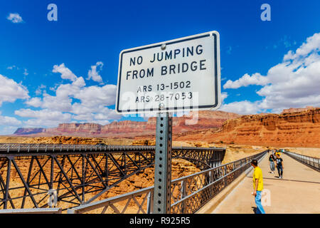 Navajo Bridge is a pair of steel spandrel arch bridges that cross the Colorado River near Lees Ferry in northern Arizona. The newer bridge of the pair - Stock Image