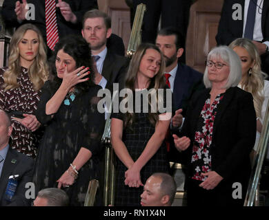February 5, 2019 - Washington, District of Columbia, U.S. - Heather Armstrong wipes away a tear as she and Madison Armstrong and Debra Bissell are introduced by United States President Donald J. Trump during his second annual State of the Union Address to a joint session of the US Congress in the US Capitol in Washington, DC on Tuesday, February 5, 2019. They represent three surviving generations of the family of Gerald and Sharon David of Reno, Nevada, who were murdered in their home by an illegal immigrant in January 2019. Pictured behind Ms. Armstrong are Lara Trump, left and Eric Trump, - Stock Image