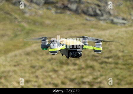 Close Up of a Drone Flying in a Mountain Environment - Stock Image