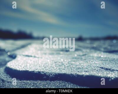 Snow shined with sun.  Beautiful real snow background with snowflakes reflections - Stock Image