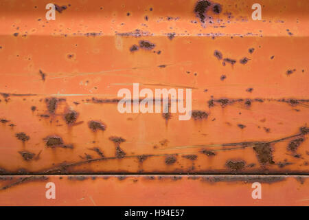 Rusty red metal background texture. - Stock Image