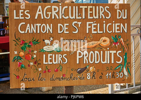 Saint Felicien Ardeche Rhone Alps France and a French language sign advertising a farmers market in the town. - Stock Image