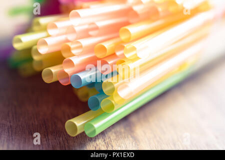 Macro Of A Bunch Colored Drinking Straws On A Wooden Table - Stock Image
