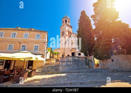 Town of Cavtat stone church sun haze view, south Dalmatia region of Croatia - Stock Image