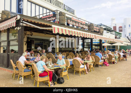 LANZAROTE, SPAIN-4th Nov 2017: Tourists and customers dine outside the restaurant of Grill Volcan De Timanfaya in - Stock Image