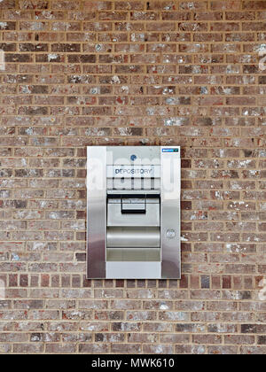 Bank or savings institution or credit union depository for money deposits also known as a night deposit box, in Montgomery Alabama, USA. - Stock Image