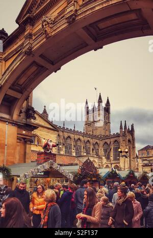 Bath Abbey & the famous Christmas Markets. This world famous city in Somerset, England is renowned for it's Roman Baths & architecture. During December many thousands visit the Christmas Markets. - Stock Image