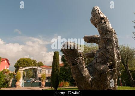 Large bronze hand sculpture in Roquebrune Park, France - Stock Image