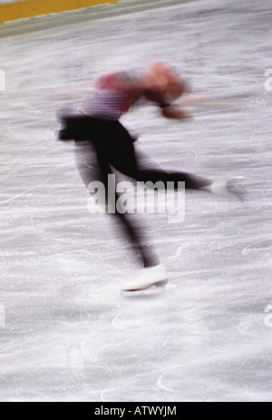 female ice skater in motion - Stock Image
