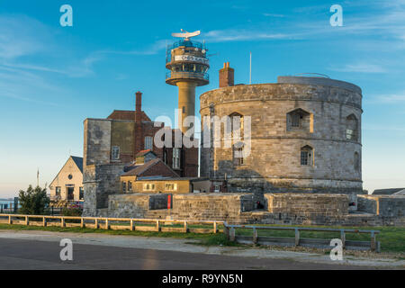Calshot Castle, an artillery fort constructed by Henry VIII on the Calshot Spit, and coastguard tower, Hampshire, UK. Landmark, heritage, historic. - Stock Image
