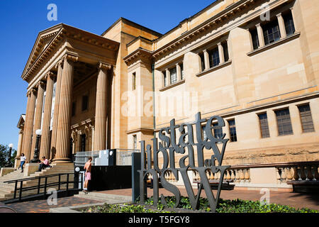 State Library NSW and sandstone Mitchell Wing in Sydney city centre,New South Wales,Australia - Stock Image