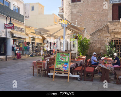 Street corner with open air restaurant in the old city centre in Famagusta in Northern Cyprus - Stock Image